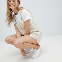 ASOS DESIGN Dungaree Playsuit In Floral Print at asos.com