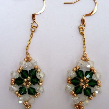 Gold plated dangling earrings with green swarovski crystals, gold Miyuki seed beads and clear crystals in a flower pattern. Handmade