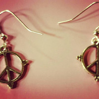 Peace sign fish hook earrings. Cute and adorable women's fashion accessories. Lightweight metal earrings for pierced ears. The perfect gift.