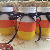 Painted candy corn mason jars for Halloween decorations, center pieces, holiday decor, Halloween decor, and organization
