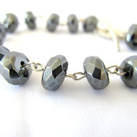 Hematite gemstone bracelet faceted with toggle clasp