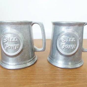 Two vintage Wilton Armetale All Gone mugs, traditional tankard shape