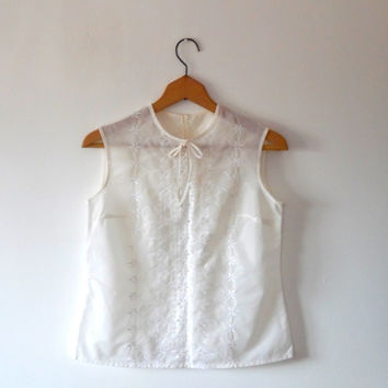 Cream broidered anglais blouse. pretty. floral. cut out. white. embroidered. tie. vintage. 80s. button. semi- sheer. sleeveless blouse top