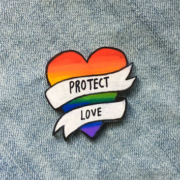 "LGBT Rainbow Heart Pin with ""Protect Love"" Banner"