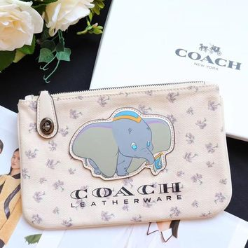 COACH 2019 new small flying elephant printing female clutch bag storage bag