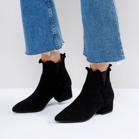 SixtySeven Black Suede Ruffle Ankle Boots at asos.com