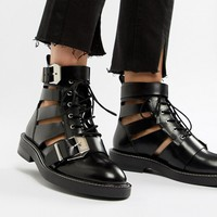 ASOS DESIGN Premium Archer leather cut out ankle boots at asos.com