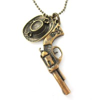 Realistic Gun Pistol Revolver and Cowboy Hat Shaped Pendant Necklace in Bronze | DOTOLY