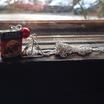 Harry Potter and the Deathly Hallows miniature book necklace.