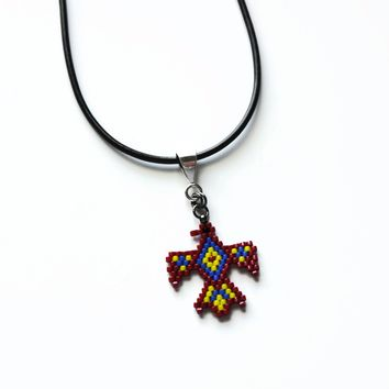 Thunderbird Necklace In Red, Blue, And Yellow On Adjustable Brown Cord