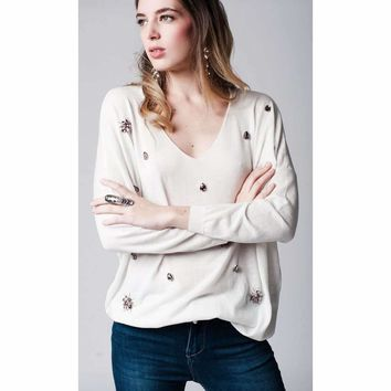White light weight knitted sweater with stone embellishment