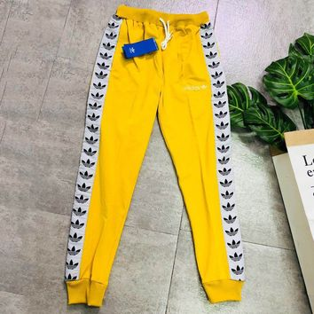 ADIDAS tide brand men and women classic clover string sports trousers Yellow