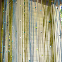 blue green curtain with beads