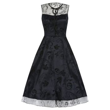 This cute as button swing dress features Sheer floral flocked mesh, navy blue satin underlay slightly short than mesh, black dart at center of bodice, cinched in waist, front keyhole and tie at neckline, full flare skirt, and finish with hidden side zip cl
