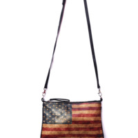 Flirty and fun, the American Flag Print Crossbody/Wristlet is a perfect sidekick for the necessities of daily life. Whether you're craving a charming touch to add to your Sunday brunch outfit, or need some leather flair for a late night outing, The Madison