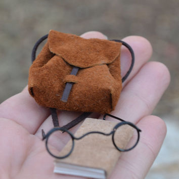Add a Backpack, glasses and book to your mouse with this listing