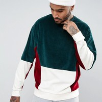ASOS Oversized Velour Cut & Sew Sweatshirt In Green at asos.com
