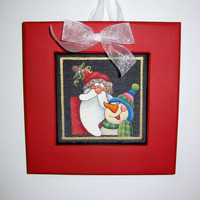 Santa and Snowman Christmas Decoration Whimsical design Framed in Red with White Bow