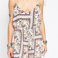 Glamorous Festival Playsuit With Pom Hem Detail Border Print at asos.com