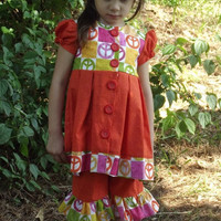 Girls size 3 dress top and ruffled shorts, orange,  short sleeves, pleated skirt, button front