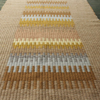 Handwoven tan, gold and blue wool rug