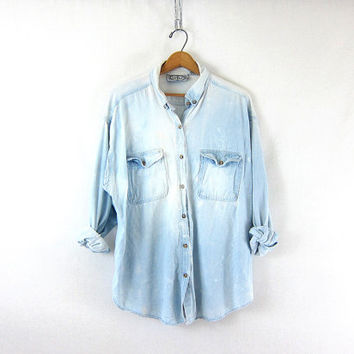 vintage distressed jean shirt. washed out faded denim shirt. button down shirt. pocket shirt.