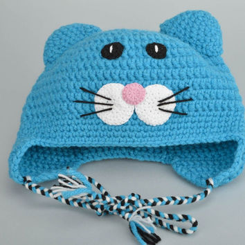 Handmade designer children's hat crocheted of blue cotton and woolen thread