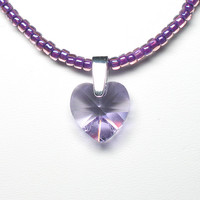 Violet crystal heart pendant on beaded necklace