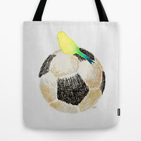 bird on a soccer ball Tote Bag by deppo