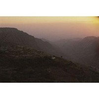 A view of Dana, Jordan and the surrounding landscape at twilight