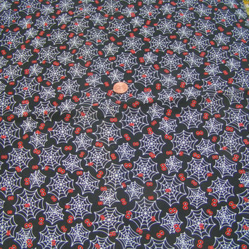 White Spider Web with Orange Eyes on a Black Background. Goth, Spooky, Halloween a fun fabric.
