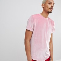 ASOS DESIGN longline t-shirt with curved hem in pink velour at asos.com