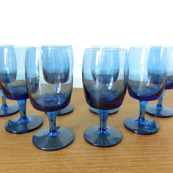 Eight blue Gorham Accent wine glasses, sleek mid century barware