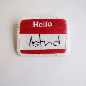 Personalized hand embroidered name brooches red Hello with your name stitched in black on cream muslin with cream felt backing MADE TO ORDER