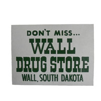 "Vintage Sign Wall Drug - Gray with Green Text ""Don't Miss. . . Wall Drug Store"""