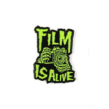 Film Is Alive Skeleton Pin (Glow-in-the-Dark)