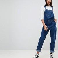 ASOS DESIGN Tall denim overall in stonewash blue at asos.com