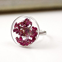 Sterling ring with real ERICA, radiant orchid. Delicate sterling ring with glass lense filled with real dried erica blossoms.