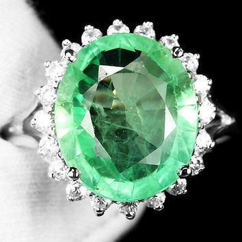 A Vintage 8.25CT Oval Cut Green Emerald Halo Engagement Ring