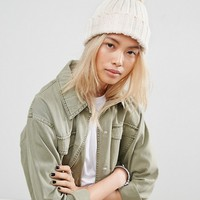 ASOS Knitted Pom Beanie with Turn Up at asos.com