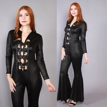 69caa5c1347 Vintage 70s JUMPSUIT   1970s Shiny Black Cut-Out Lace Up Flared
