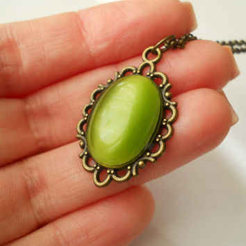 Olive green pendant, olive green necklace, cat eye oval cabochon, antique brass necklace, oval pendant, small pendant, cabochon pendant