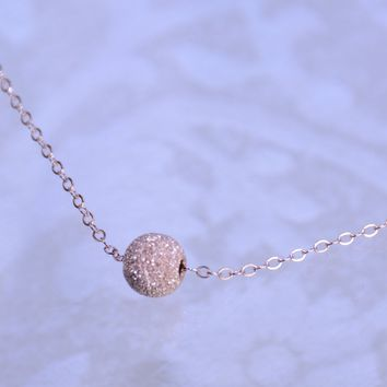 Rose gold stardust ball necklace