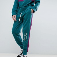 Mennace Retro Joggers In Teal With Logo at asos.com