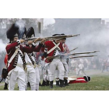 Redcoats shoot muskets in a reenactment of the Battle of Bunker Hill