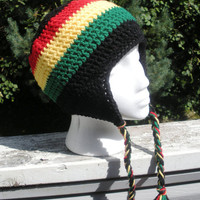 Unisex crochet Rasta earflap beanie in solid black with Rasta stripes and accents of red gold and green, ready to ship.