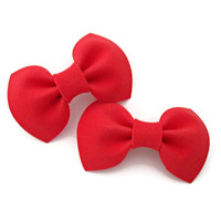 Set of two small red bows on barrette clips