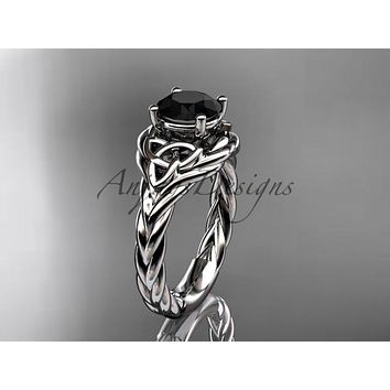 14kt white gold celtic trinity twisted rope wedding ring with a Black Diamond center stone RPCT9125
