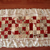 Christmas patchwork table runner with a hand embroidered garland. Quilted table runner. Red table topper