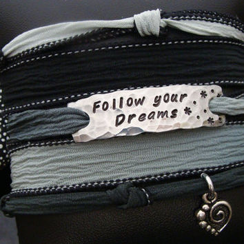 """D2E silk wrap bracelet hand stamped """"follow your dreams"""" with heart charm and magnetic clasp"""